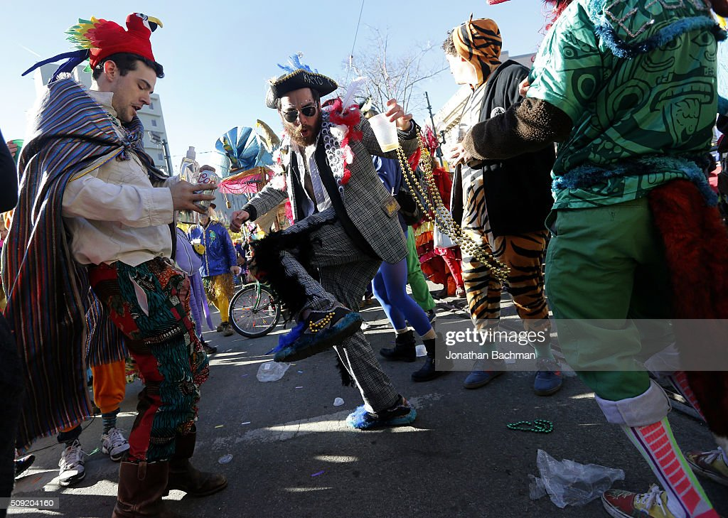 Members of the Mondo Kayo Social and Marching Club parade down St. Charles Avenue during Mardi Gras day on February 9, 2016 in New Orleans, Louisiana. Fat Tuesday, or Mardi Gras in French, is a celebration traditionally held before the observance of Ash Wednesday and the beginning of the Christian Lenten season.