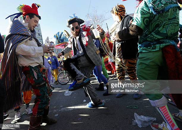 Members of the Mondo Kayo Social and Marching Club parade down St Charles Avenue during Mardi Gras day on February 9 2016 in New Orleans Louisiana...