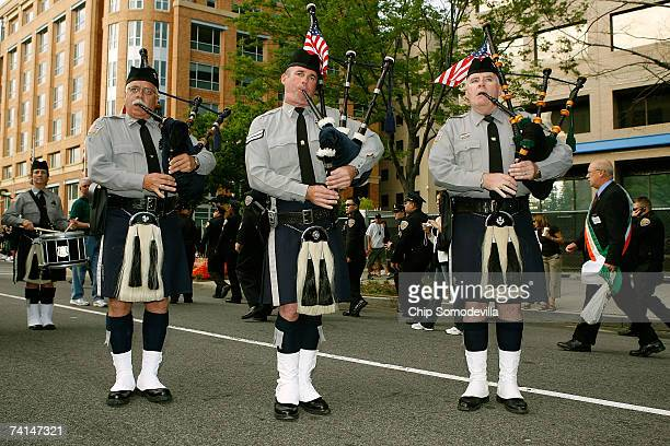 Members of the Monmouth New Jersey County Police Pipes and Drums join hundreds of law enforcement bagpipe players and honor guards for the Twelfth...