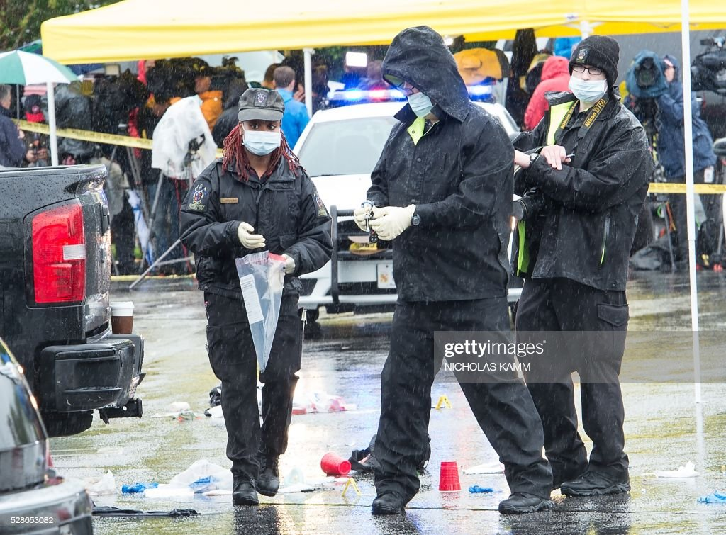 Members of the Montgomery County police collect evidence at the scene of a shooting in the parking lot of the Westfield Montgomery Mall in Bethesda, Maryland, on May 6, 2016 in which one person was killed and two others wounded. A federal police office was taken into custody Friday after shootings in suburban Washington shopping centers that left two people dead and two others wounded. Authorities said they had taken into custody Eulalio Tordil, a 62-year-old officer in the Department of Homeland Security's Federal Protective Service, which protects US government facilities. KAMM
