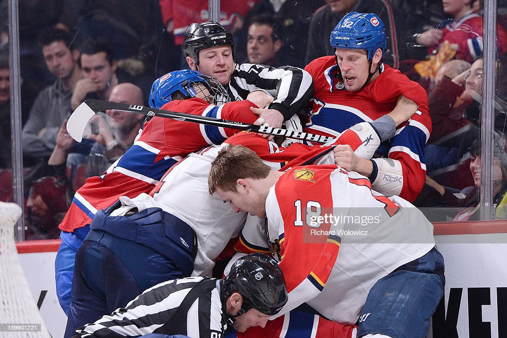 Members of the Montreal Canadiens and Florida Panthers mix it up during the NHL game at the Bell Centre on January 22, 2013 in Montreal, Quebec, Canada. The Canadiens defeated the Panthers 4-1.