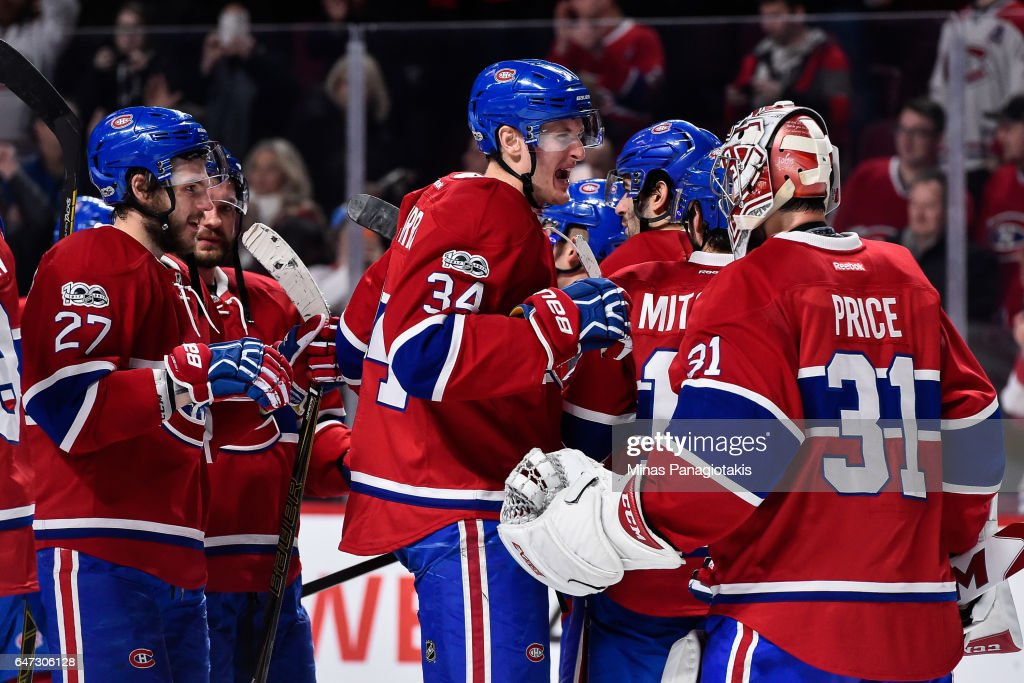 Members of the Montreal Canadiens celebrate a victory during the NHL game against the Nashville Predators at the Bell Centre on March 2, 2017 in Montreal, Quebec, Canada. The Montreal Canadiens defeated the Nashville Predators 2-1.