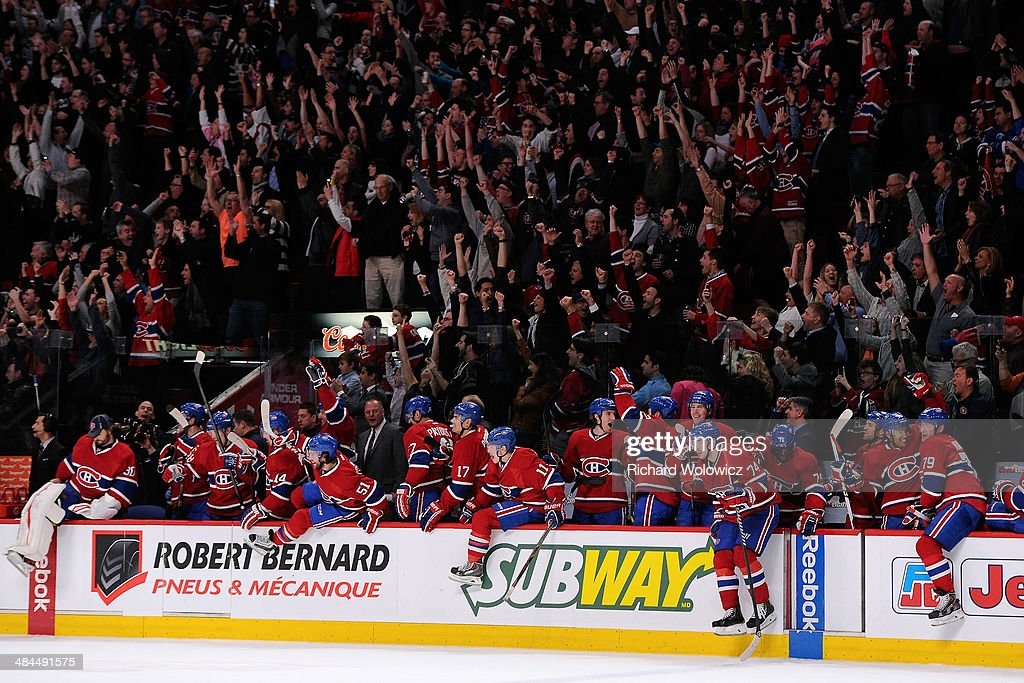 Members of the Montreal Canadiens celebrate after the game winning goal was scored by Brian Gionta #21 (not pictured) during the NHL game against the New York Rangers at the Bell Centre on April 12, 2014 in Montreal, Quebec, Canada. The Canadiens defeated the Rangers 1-0 in overtime.