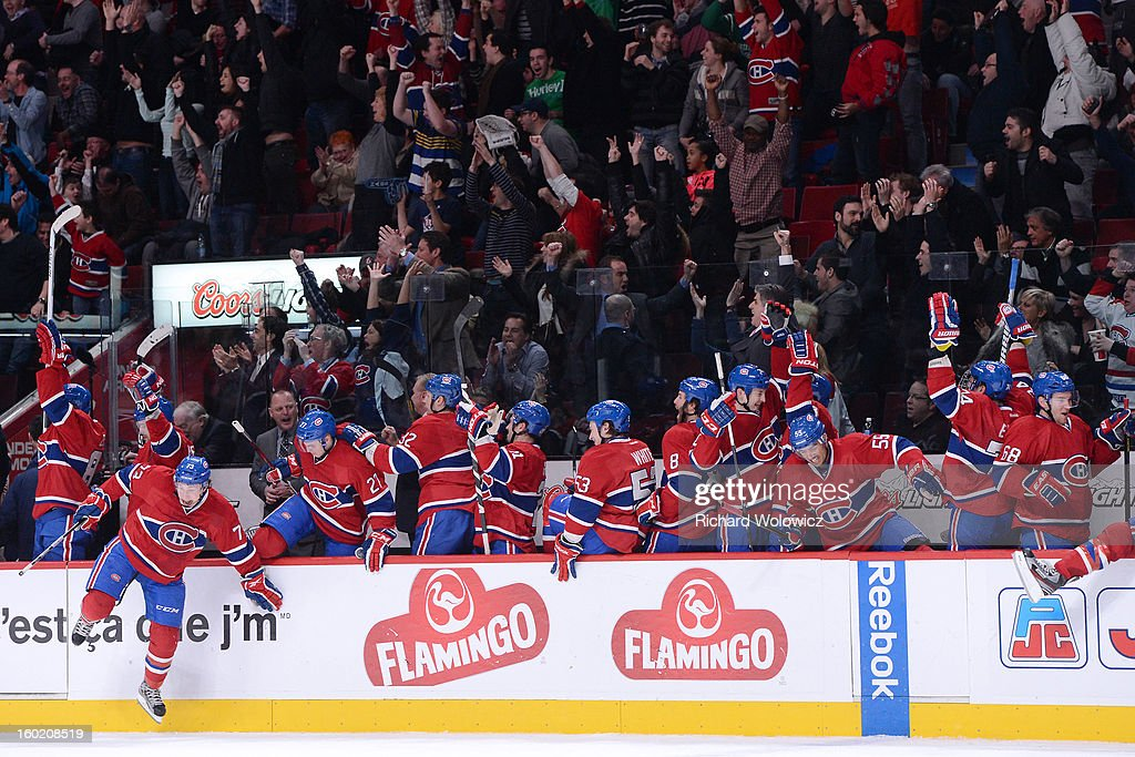 Members of the Montreal Canadiens celebrate the overtime goal from teammate Andrei Markov #79 (not pictured) during the NHL game against the New Jersey Devils at the Bell Centre on January 27, 2013 in Montreal, Quebec, Canada. The Canadiens defeated the Devils 4-3 in overtime.