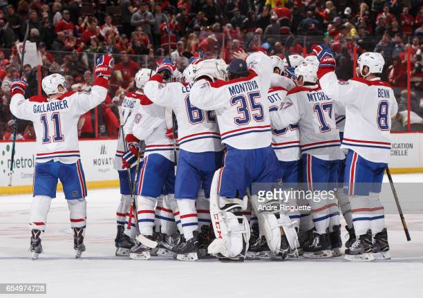 Members of the Montreal Canadiens including Brendan Gallagher Al Montoya Torrey Mitchell and Jordie Benn celebrate their shootout win over the Ottawa...