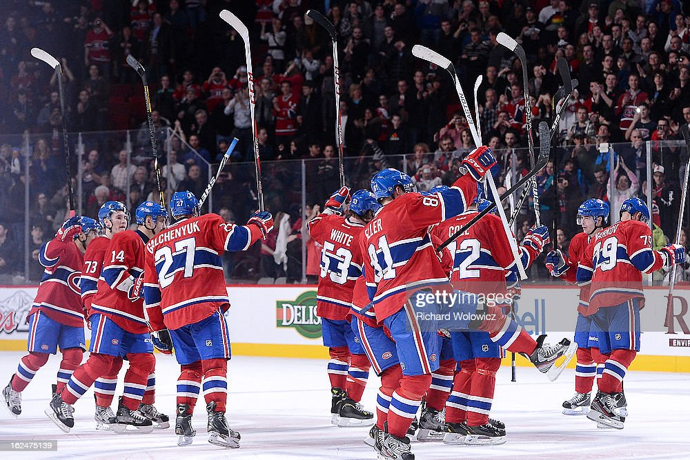 Members of the Montreal Canadiens wave to fans after defeating the New York Rangers during the NHL game at the Bell Centre on February 23, 2013 in Montreal, Quebec, Canada. The Canadiens defeated the Rangers 3-0.