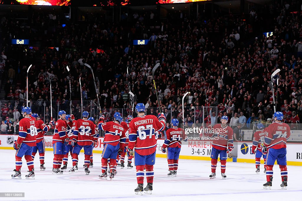Members of the Montreal Canadiens wave to fans after defeating the New York Rangers in their NHL game at the Bell Centre on March 30, 2013 in Montreal, Quebec, Canada. The Canadiens defeated the Rangers 3-0.
