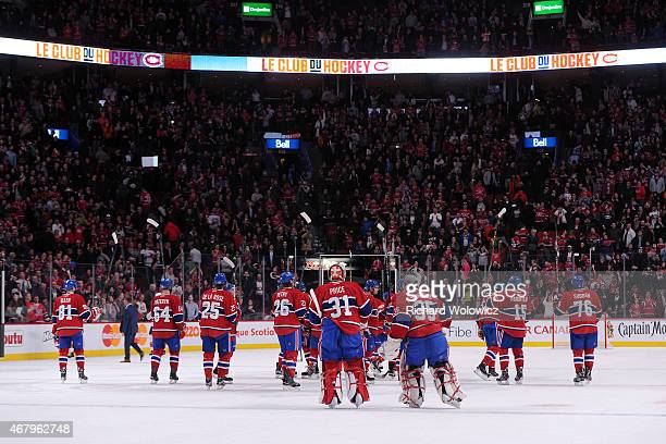 Members of the Montreal Canadiens wave to fans after defeating the Florida Panthers during the NHL game at the Bell Centre on March 28 2015 in...