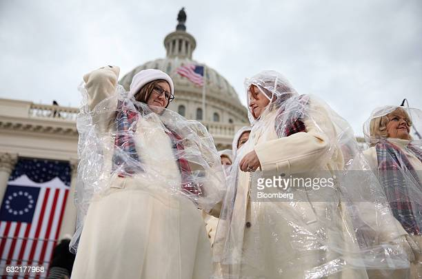 Members of the Mormon Tabernacle Choir put rain ponchos on ahead of the 58th presidential inauguration in Washington DC US on Friday Jan 20 2017...
