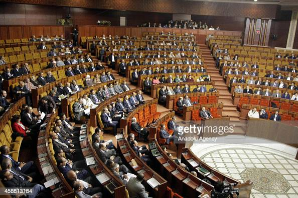 Members of the Moroccan Parliament listen to Prime Minister Abdelilah Benkirane at the Parliament in Rabat Morocco on November 11 2014