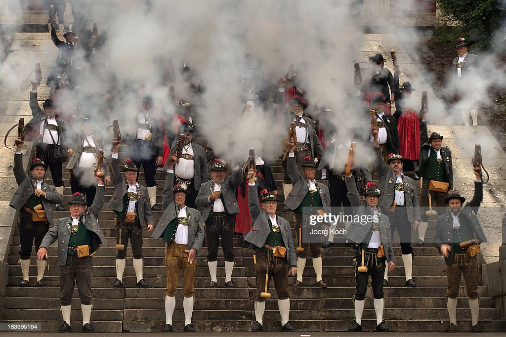 Members of the mountain riflemen's associations in typical Bavarian costumes fire a shot by order of their commander during the traditional 'Boellerschiessen' (ceremonial firing of a gun) on the last day of Oktoberfest 2013 beer festival at Theresienwiese on October 6, 2013 in Munich, Germany. The Munich Oktoberfest, often simply called 'Wiesn', is the world's largest beer fest and draws millions of visitors. The Oktoberfest 2013 started on September 21 and ends today on October 6.