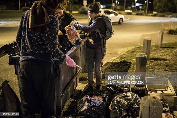 Members of the movement 'Les Gars'Pilleurs' collect food from waste containers of a supermarket in the south of Lyon France on late September 24 2015...