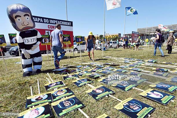 Members of the Movement Vem Pra Rua set up boards depicting congressists against and in favour of the impeachment of President Dilma Rousseff in...