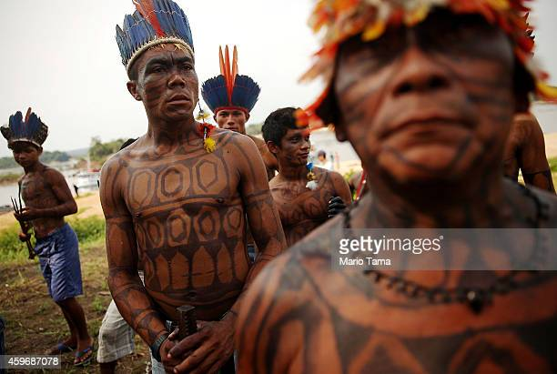 Members of the Munduruku indigenous tribe gather along the Tapajos River during a 'Caravan of Resistance'' protest by indigenous groups and...