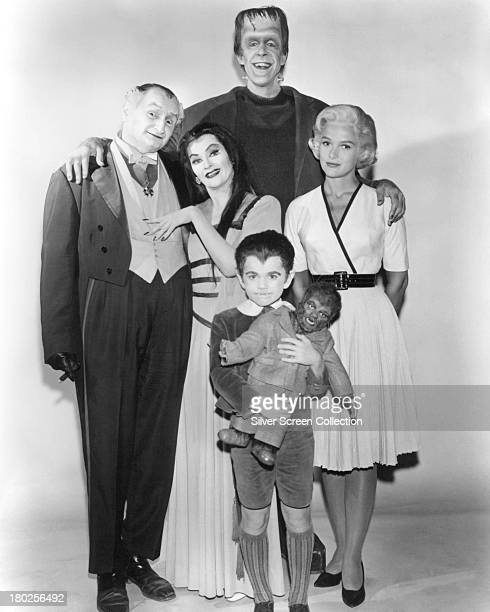 Members of the Munster family in a publicity still for season one of the comedyhorror TV series 'The Munsters' 1964 Left to right Al Lewis as Grandpa...