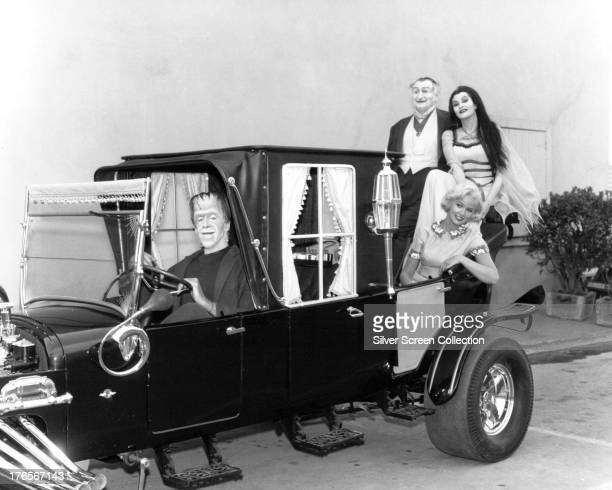 Members of the Munster family on board the Munster Koach in a publicity still for the comedyhorror TV series 'The Munsters' circa 1965 Clockwise from...