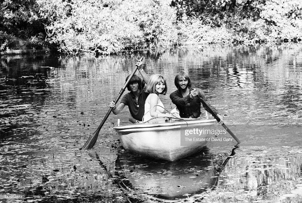Members of the musical group the Bee Gees and pop singer Lulu (l-r Barry Gibb, Lulu, Maurice Gibb) enjoy a boat ride in July 1969 in London, England. Lulu was married to Maurice Gibb from 1969 to 1973.