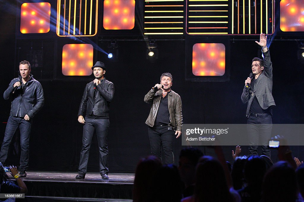 Members of the musical group The Tenors perform during the We Day Minnesota event at the Xcel Energy Center in St. Paul, Minnesota on October 8, 2013