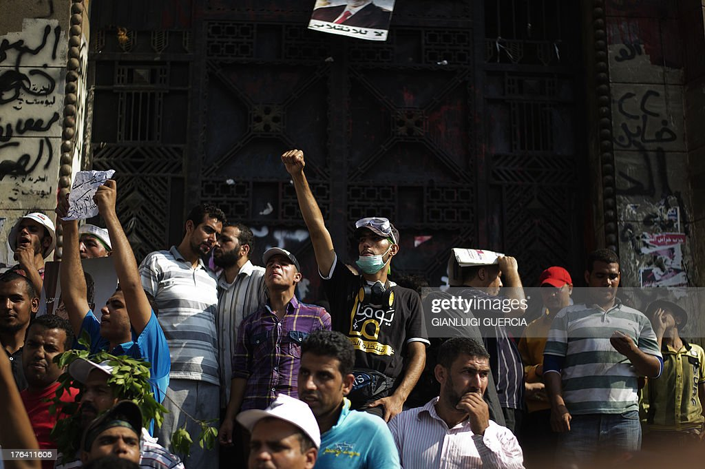 Members of the Muslim Brotherhood and supporters of Egypt's ousted president Mohammed Morsi demonstrate outside the High Court in Cairo on August 12, 2013. Egypt's judiciary said it was extending Morsi's detention for a further 15 days pending an investigation into his collaboration with Hamas, which rules neighbouring Gaza.