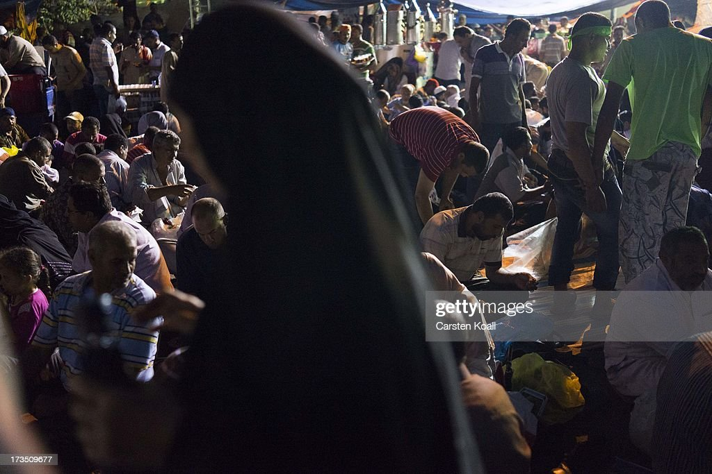 Members of the Muslim Brotherhood and supporters of ousted president Mohamed Morsi pray at a rally outside Rabaa al-Adawiya mosque on July 15, 2013 in Cairo, Egypt. Senior US official William Burns has arrived in Egypt for the first time since the overthrow of Mohamed Morsi.