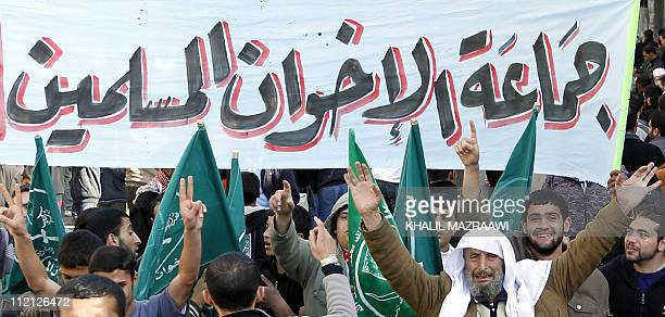 Members of the Muslim Brotherhood movement shout slogans as thousands of Jordanians demonstrated peacefully in Amman and other cities after weekly...