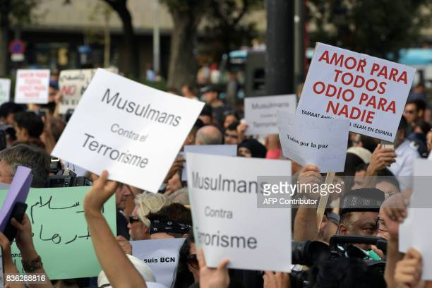 Members of the muslim community demonstrate at Plaza de Catalunya in Barcelona on August 21 2017 to protest against terrorism four days after the...