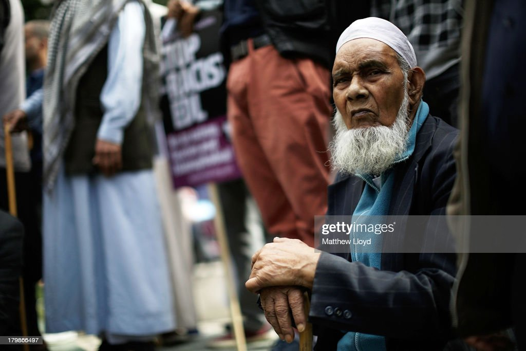 Members of the Muslim community join anti-fascist protestors at Altab Ali Park in a counter protest to the English Defence League's march to Tower Hamlets on September 7, 2013 in London, England. The EDL far-right organisation have had restrictions placed on the march by the Metropolitan police due to the fear of 'serious public disorder', but it will still proceed to the edge of Tower Hamlets, which is home to a large population of ethnic minorities.