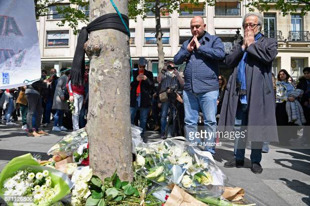 Members of the Muslim community lay flowers following the shooting of a police officer being shot yesterday on the Champs Elysees on April 21 2017 in...