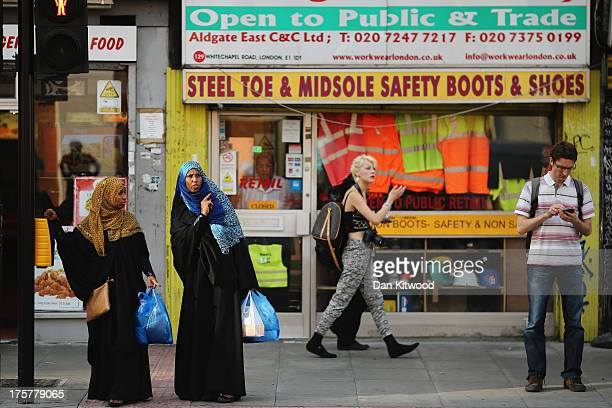 Members of the Muslim community make their way to pray at the East London Mosque on the last day of Ramadan on August 7 2013 in London England The...