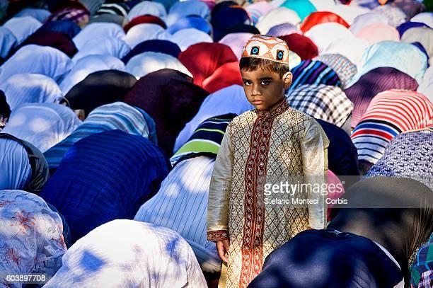 Members of the Muslim community perform Eid alAdha prayer at Piazza Vittorio squarein Rome's Esquilino multiethnic quarte on September 12 2016 in...