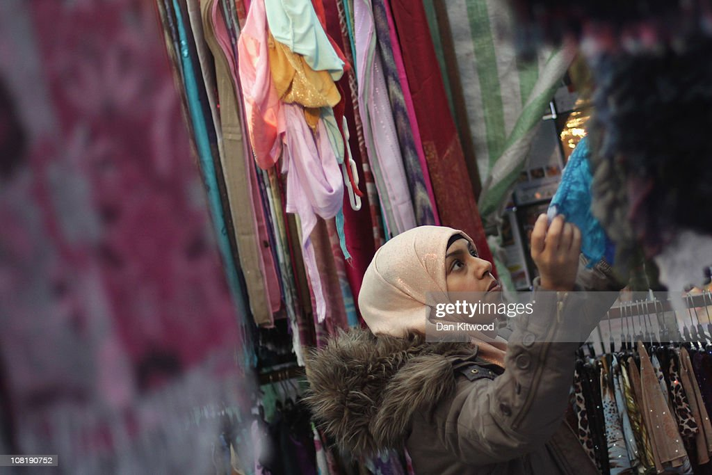 Members of the Muslim community shop in Whitechapel on January 20 2011 in London England Baroness Warsi the cochairman of the Conservative Party...