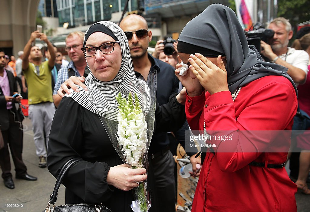 Members of the Muslim community show their respect at Martin Place on December 16 2014 in Sydney Australia Sydney siege gunman Man Haron Monis was...