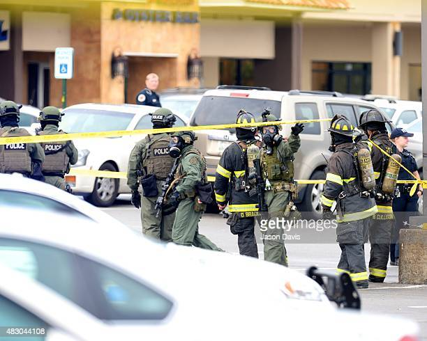 Members of The Nashville Fire Department and Metro Police enter Hickory Hollow Cinemas on August 5 2015 in Antioch Tennessee According to reports an...