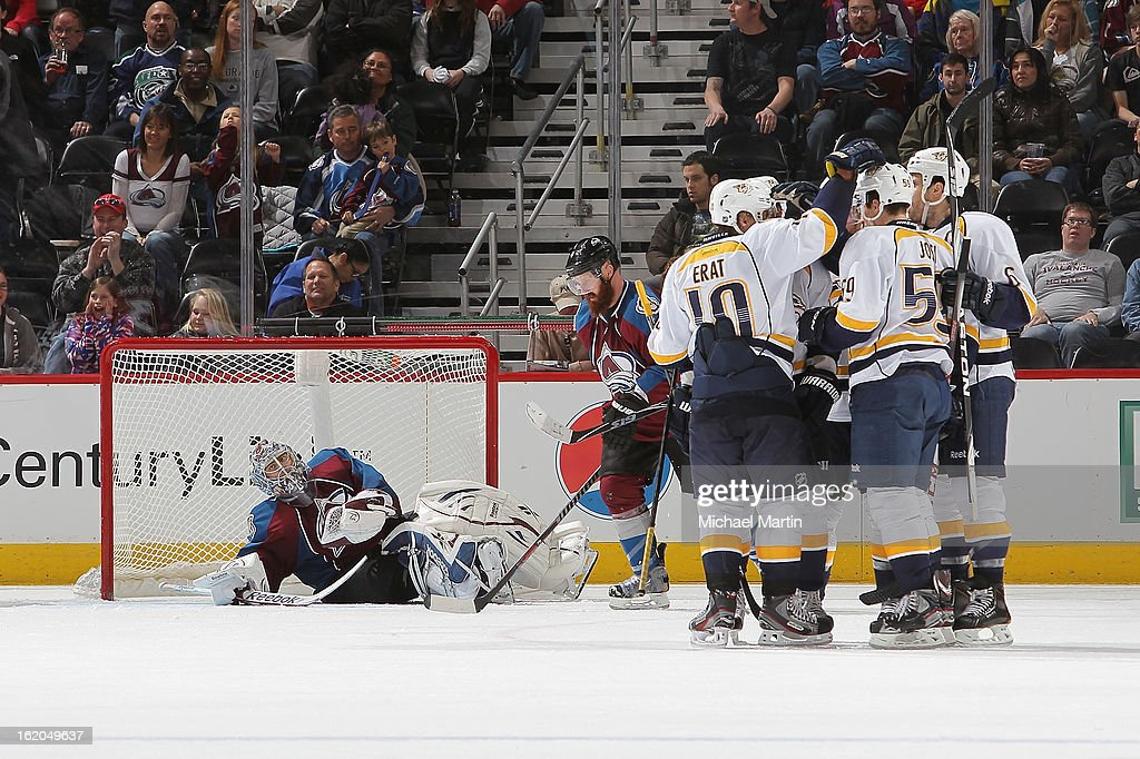 Members of the Nashville Predators celebrate against the Colorado Avalanche at the Pepsi Center on February 18, 2013 in Denver, Colorado. The Avalanche defeated the Predators 6-5.