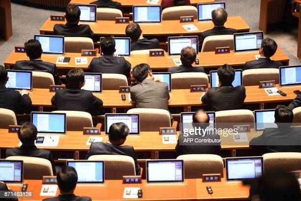 Members of the National Assembly listen to US President Donald Trump delivering his addresses in Seoul on November 8 2017 Trump's marathon Asia tour...