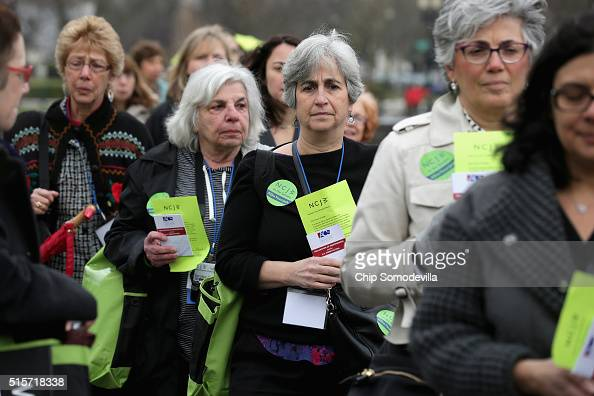 Members of The National Council for Jewish Women from across the country line up on the East Front of the US Captiol to hand in hundreds of small...