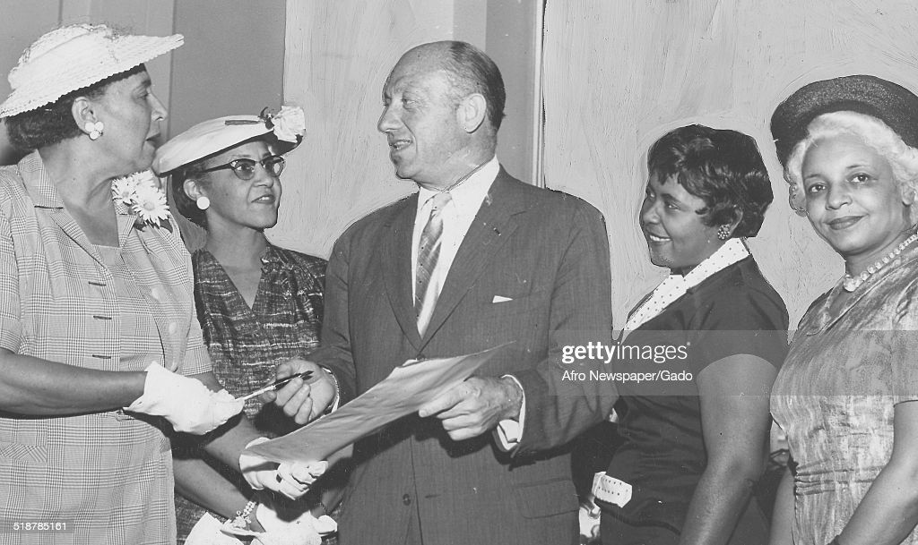 Members of the National Council of Negro Women (NCNW) and former New York Senator Jacob K Javits during a reception following the signing of a tax relief bill by Dwight Eisenhower, 1959.