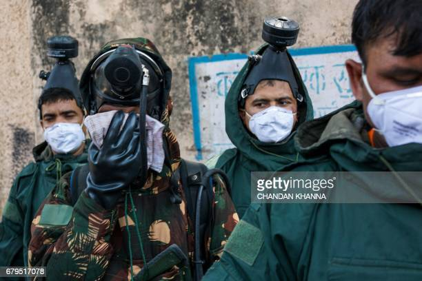 Members of the National Disaster Response Force prepare to take part in the cleanup operation at a container depot where a gas leak occurred in New...