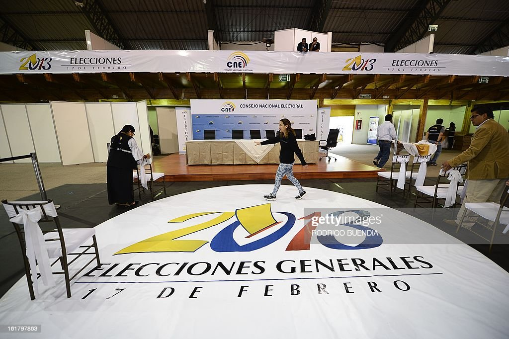 Members of the National Election Council (CNE) check final details on the eve of general elections in Quito on February 16, 2013. Almost 12 million people are eligible to vote in Ecuador's presidential election, with President Rafael Correa tipped to win re-election by a landslide.