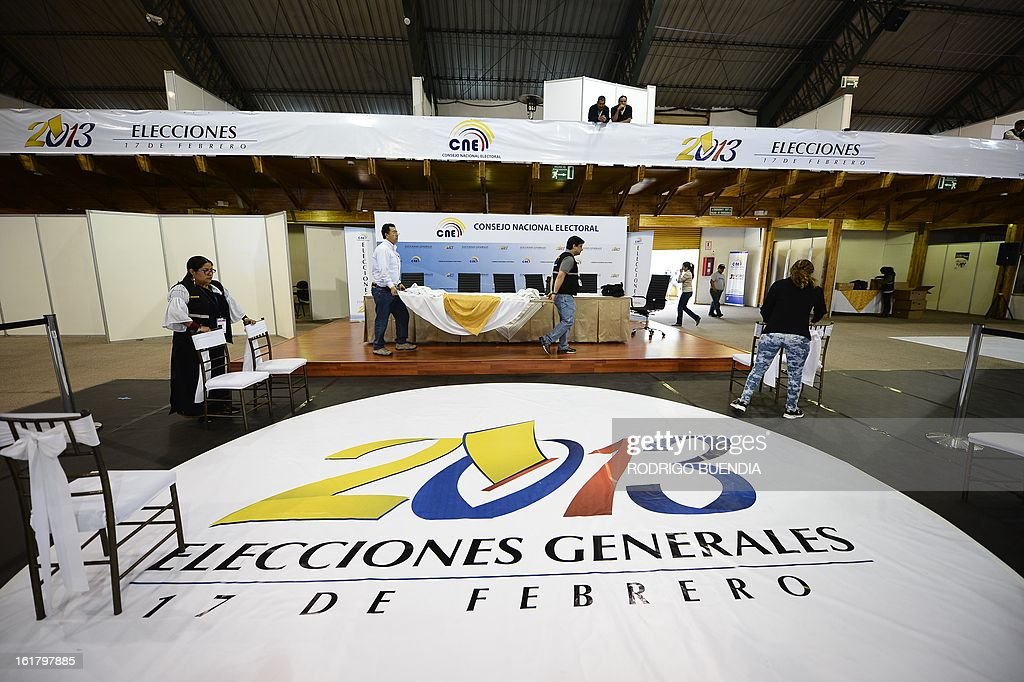 Members of the National Election Council (CNE) put finishing touches on the eve of general elections in Quito on February 16, 2013. Almost 12 million people are eligible to vote in Ecuador's presidential election, with President Rafael Correa tipped to win re-election by a landslide.
