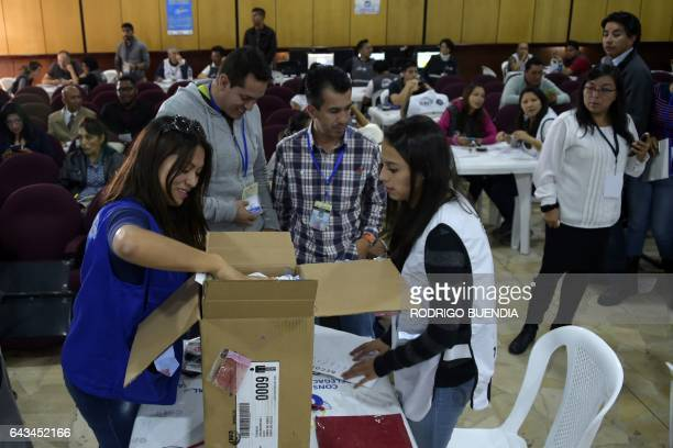 Members of the National Electoral Council open a ballot box during the counting of votes in Quito on February 21 2017 The delay in the release of the...