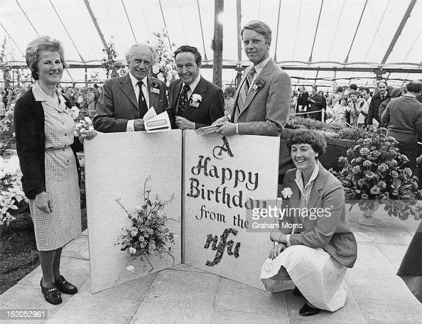 Members of the National Farmers Union with an outsize birthday card to the Queen Mother at their stand at the Chelsea Flower show London 23rd May 1980
