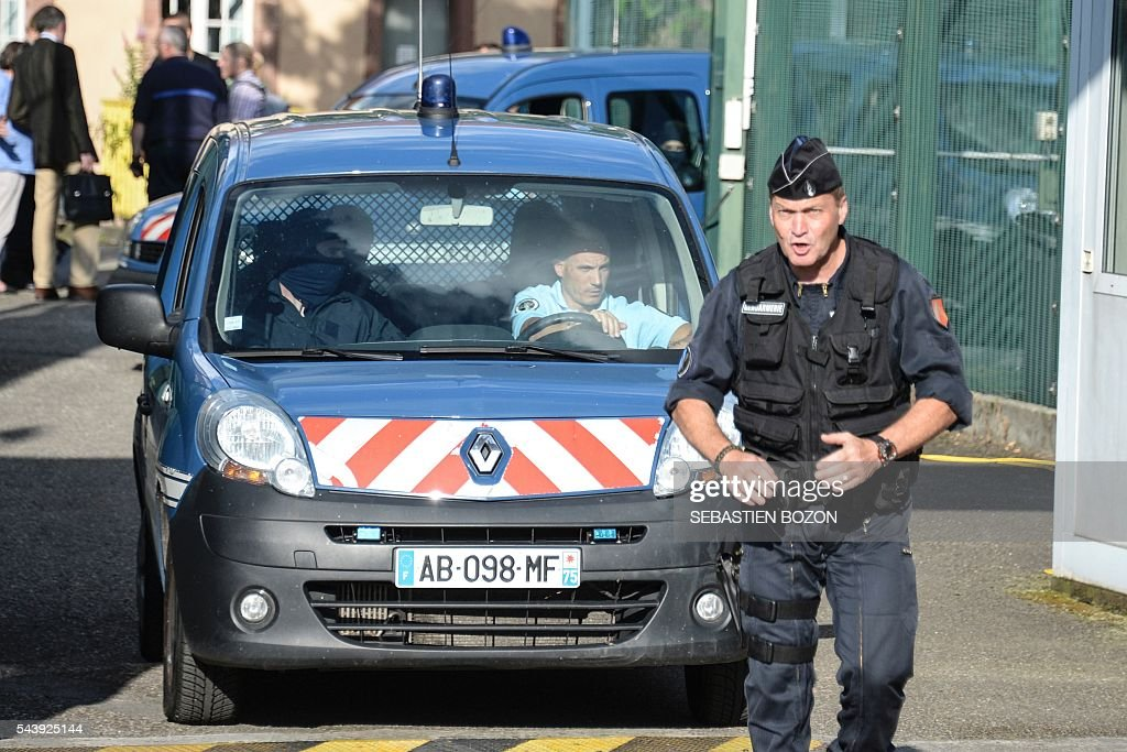 Members of the National Gendarmerie Intervention Group (GIGN) and French Gendarmerie leave the Ensisheim prison, northeastern France, after a psychologist was taken hostage by a prisoner on June 30, 2016. / AFP / SEBASTIEN