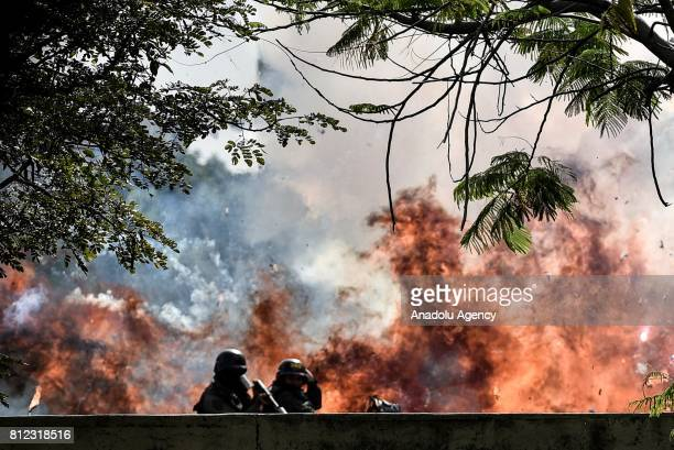 Members of the National Guard are caught up in a blast during protests in Caracas on July 10 2017 Venezuela hit its 100th day of antigovernment...