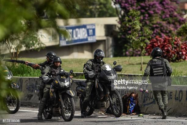 Members of the National Guard arrest an opposition activist during a protest against Venezuelan President Nicolas Maduro in Caracas on July 10 2017...