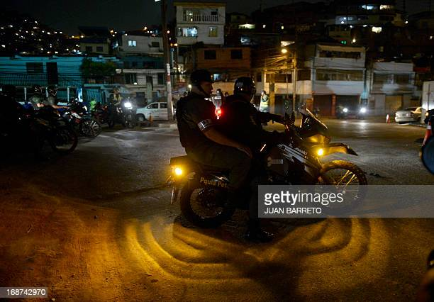 Members of the National Guard carry out a security operation in the impoverished Petare neighbourhood one of Caracas' most dangerous slums on May 13...