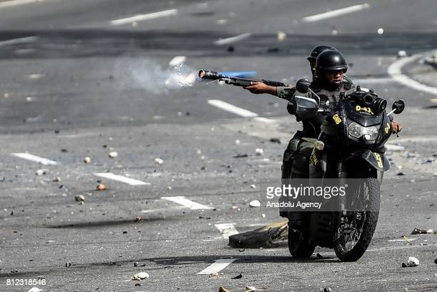 Members of the National Guard shooting tear gas and buckshots during protests in Caracas on July 10 2017 Venezuela hit its 100th day of...