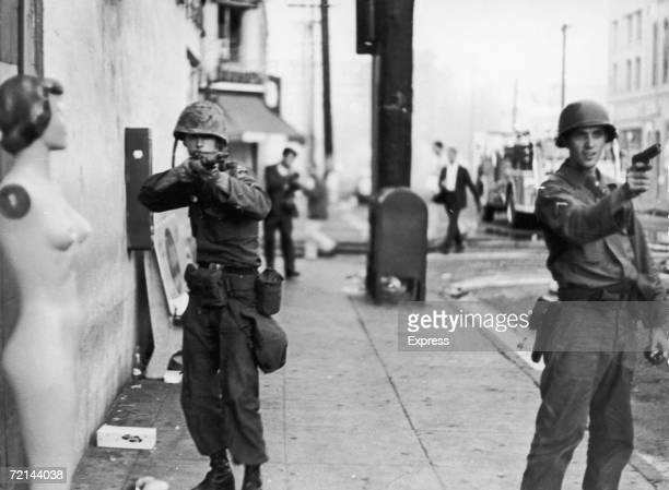Members of the National Guard take aim during rioting in the Watts area of Los Angeles during the Watts Riots August 1965