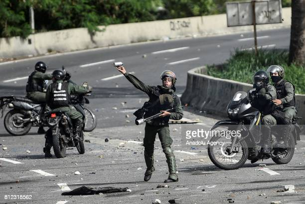 Members of the National Guard throwing tear gas during protests in Caracas on July 10 2017 Venezuela hit its 100th day of antigovernment protests...