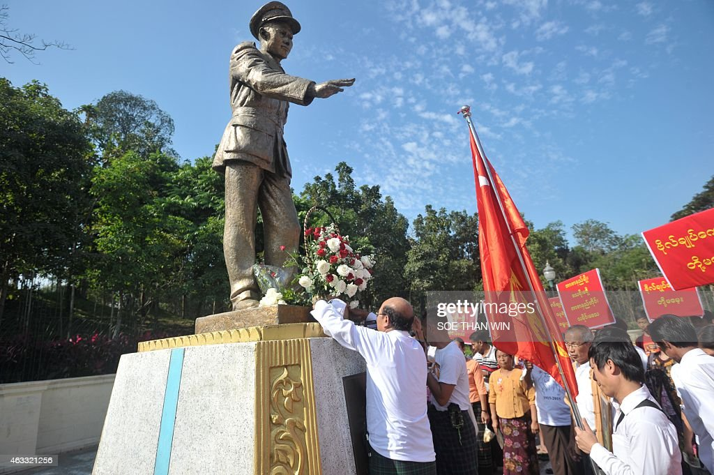 Members of the National League for Democracy (NLD) party lay a wreath in front of the late General <a gi-track='captionPersonalityLinkClicked' href=/galleries/search?phrase=Aung+San&family=editorial&specificpeople=812845 ng-click='$event.stopPropagation()'>Aung San</a> statue to mark the 100th birthday of independence hero <a gi-track='captionPersonalityLinkClicked' href=/galleries/search?phrase=Aung+San&family=editorial&specificpeople=812845 ng-click='$event.stopPropagation()'>Aung San</a>, in Yangon on February 13, 2015. Known affectionately as 'Bogyoke', or General, <a gi-track='captionPersonalityLinkClicked' href=/galleries/search?phrase=Aung+San&family=editorial&specificpeople=812845 ng-click='$event.stopPropagation()'>Aung San</a> is adored in Myanmar and credited with unshackling the country from colonial rule and embracing its ethnic minorities in a vision of unity that unraveled catastrophically in the military-dominated decades that followed his 1947 assassination.